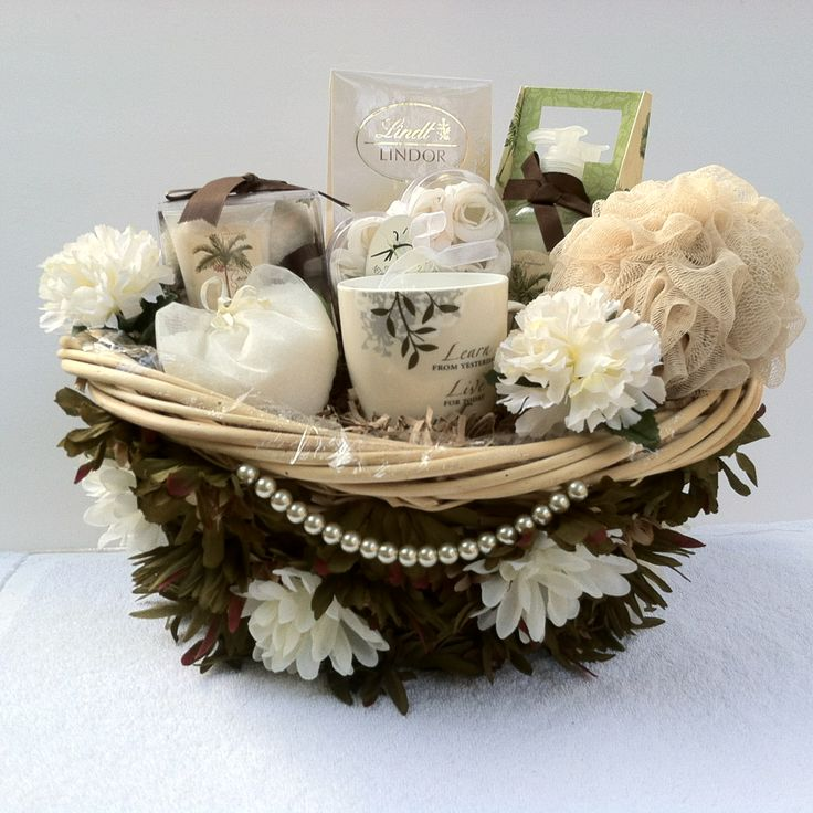 """(Spa Gift Basket) Indulge in serenity in Coconut Vanilla Bean relax an wash all your stress away take yourself on a retreat you deserve it and with our one of a kind finest decorative design basket just for you with:  1 Ultra Plush Socks&Foot Lotion 1 Bath Crystal 1 Cup 1 Candle 1 Bath Sponge 1 Bath Caddy Shower Gel & 1 Body Lotion 1 Soap Rose Petals Lindt Lindor Truffles with white chocolate with smooth filling.  """"Item Sold"""" http://www.bonanza.com/booths/pat21"""