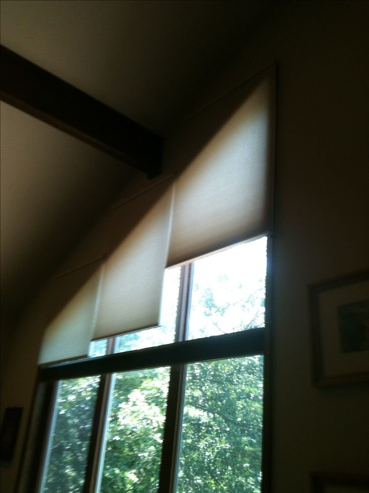 Tricky angled windows treated with Motorized Graber shades