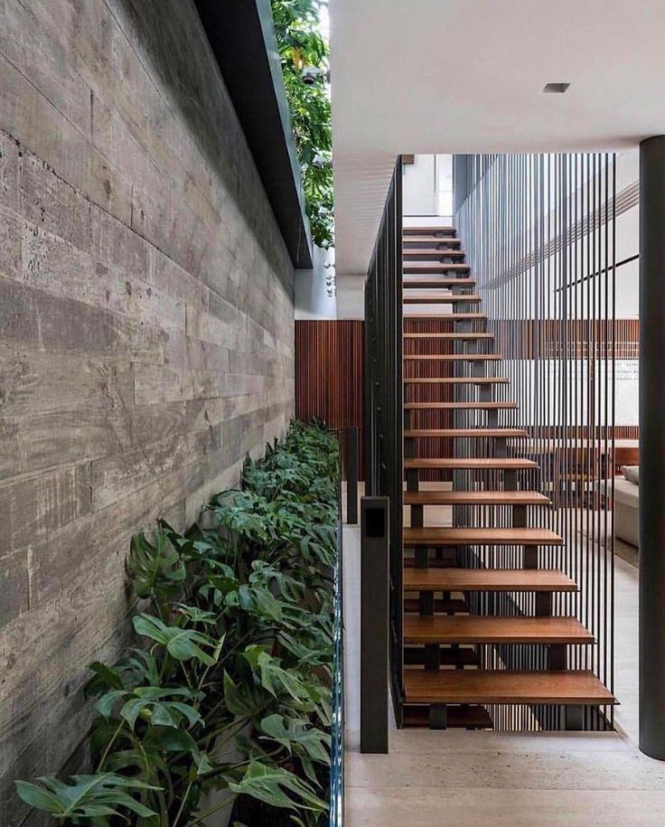 Spectacular staircase! Along with gorgeous split level gardens.