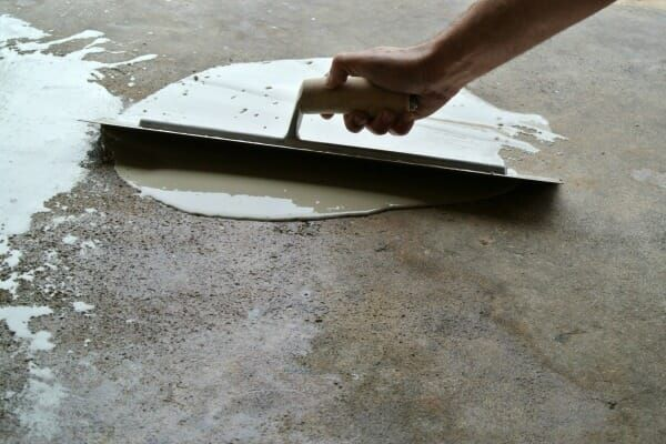Easily Repair Your Pitted Or Spalled Garage Floor All Garage Floors Garage Repair Garage Floor Concrete Floors