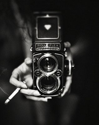 Black and white photographysmokingvintage camera