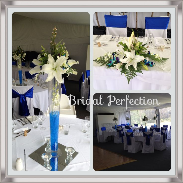 Beautiful wedding centrepieces blue and white theme using white oriental lilies and blue orchids.