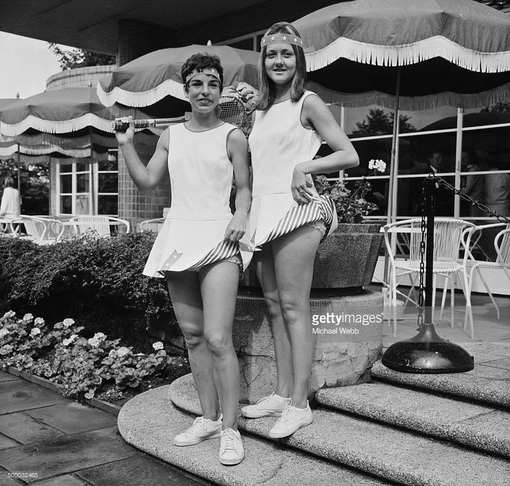 American tennis players Julie Heldman (left) and Jane 'Peaches' Bartkowicz modeling Dacron and cotton outfits by English fashion designer Ted Tinling at a press preview of the designer's new tennis wear collection at Kensington Roof Gardens, London, 20th June 1969. They are wearing 'Star-Spangled Banner' dresses, the skirts of which are trimmed with stars on blue ribbon and lined with red and white stripes.