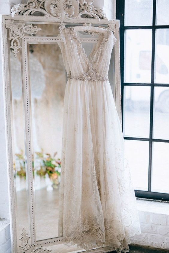 39 Getting-Ready Wedding Photos Every Bride Should Have: #13. Highlight your wedding dress style with a refined mirror