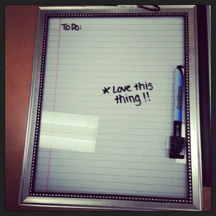 Repurposed cheap picture frame and a sheet of notebook paper: dry erase to do list :)