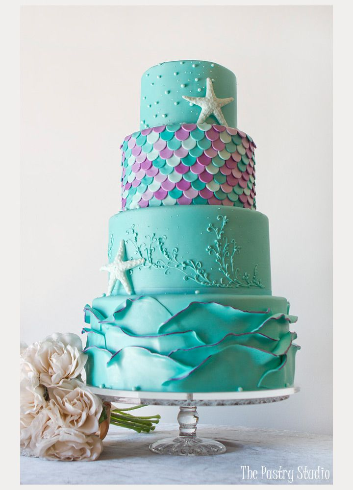 love the touches of purple on this bright turquoise beach wedding cake ~  we ❤ this! moncheribridals.com