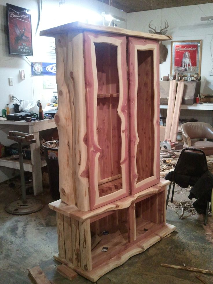 Custom Made Rustic Log Gun Cabinet or a armoire for clothes!  I think with time Luke could make that for me lol