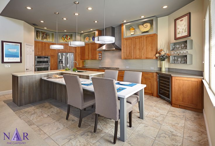 Warm transitional shaker kitchen. Integrated dining table. #NarKitchens, #ColumbiaCabinets, #Caesarstone