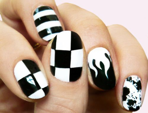 madelinepoolenails:    checkerstripeflamesplatter    A bold graphic pattern would also make a great statement for New Year's Eve.
