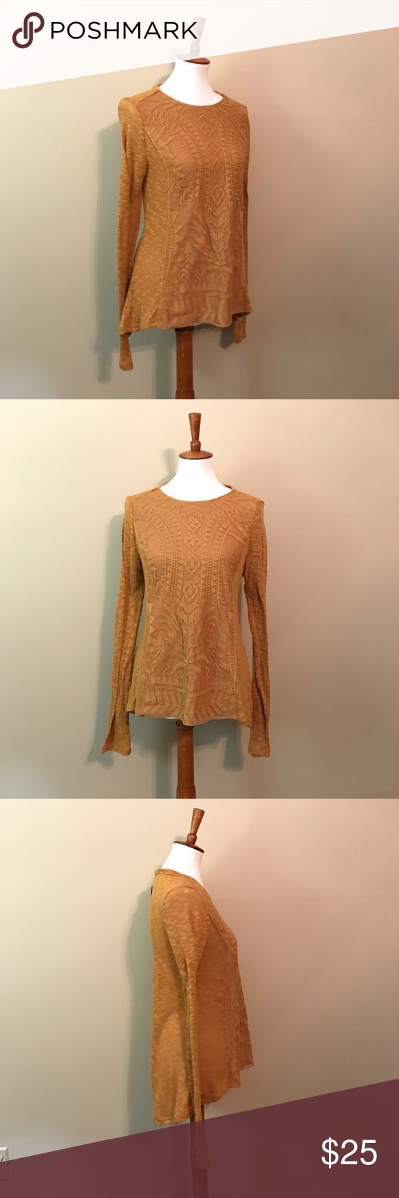 Textured Aztec Long Sleeve Shirt This yellow long sleeve shirt features a high low hem and textured aztec pattern on the front. Perfectly paired with a pair of denim. The material is polyester and spandex. No holds, no trades. Rewind Tops Tees - Long Sleeve
