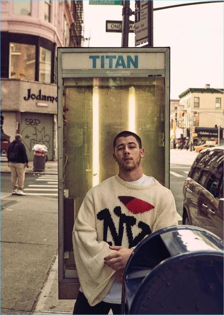 Venturing outdoors, Nick Jonas wears a Raf Simons NY sweater.