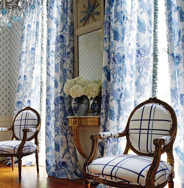 Blue and white curtains, chair upholstery, porcelain, white hydrangeas