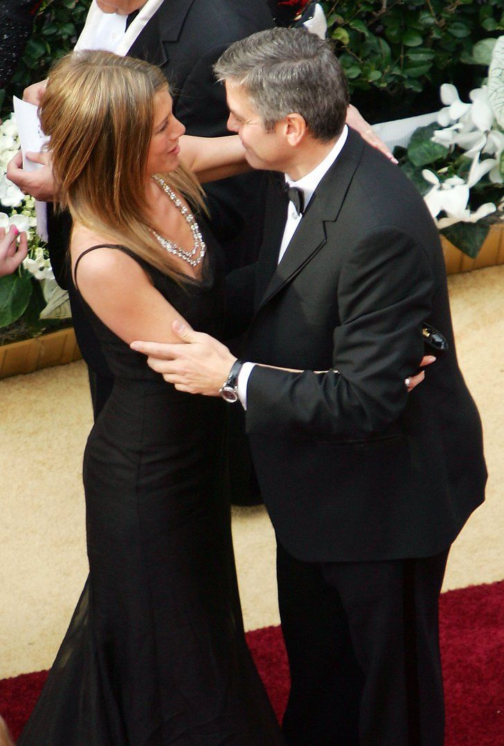 Pin for Later: Birthday Girl Jennifer Aniston's Got More Famous Friends Than We Can Count She and George Clooney shared an embrace on the Oscars red carpet in March 2006.