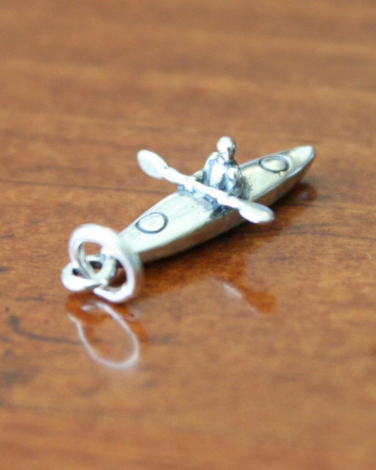 This sterling silver Kayak Charm is a great kayaking sports jewelry gift to show everyone how much you love recreational water sports. Give one to yourself or the kayak enthusiast in your life to capture all those paddling memories.