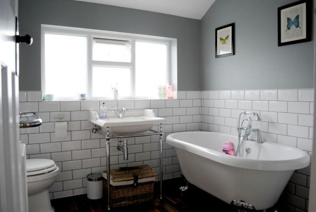 Grey bathroom with roll top bath and subway tiles on The Spirited Puddle Jumper Blog