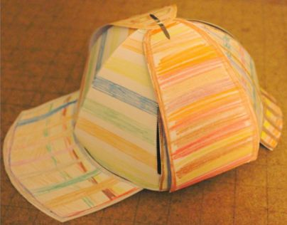 A series of worksheets allowing you to cut out and construct a deerstalker hat from paper. This model allows content to be created on the earflaps, which when folded down reveal the work as book pages. Concept by Borbonesa.