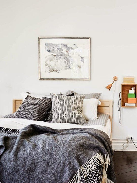 Try a wall-mounted box or shelf as a nightstand