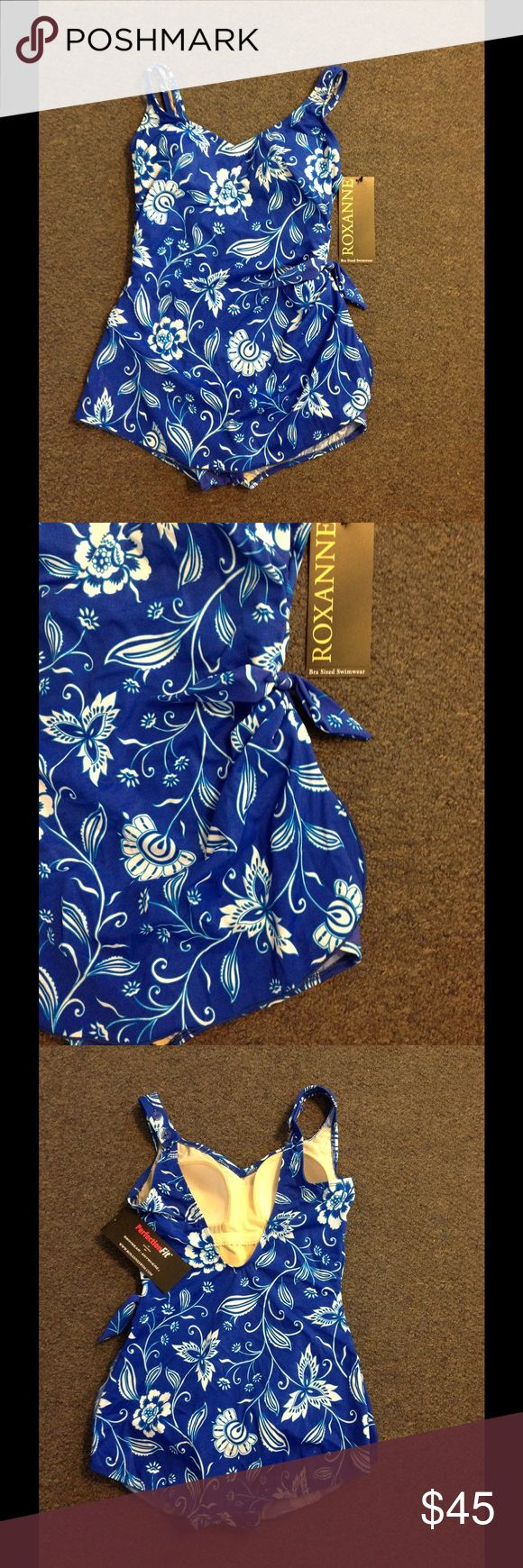 Roxanne Retro Blue Floral Print Skirt Swimsuit 12 Super nice Roxanne swimsuit. Blue floral print in size 12/36B. Extra firming tummy control with full coverage in the behind area. Skirted front with a tie on the side. Brand new with tags. Roxanne Swim One Pieces