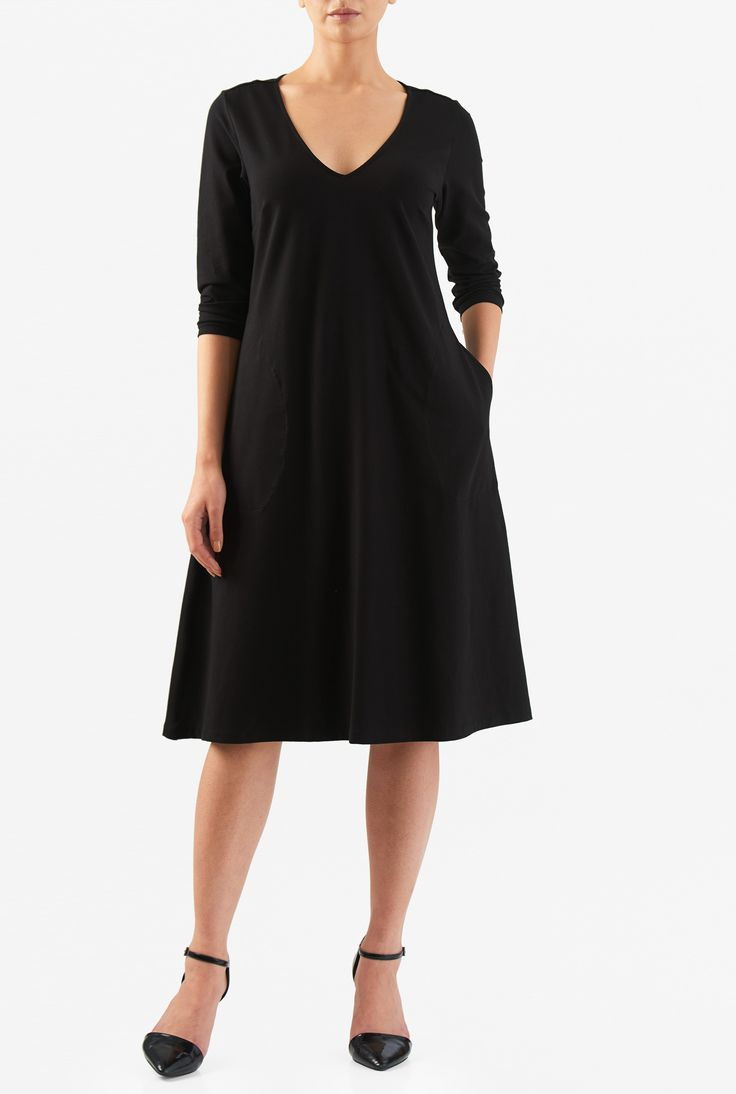 Our three-quarter length sleeve dress capitalizes on the soft drape of cotton knit with a godet at the base of a low V-neckline for a relaxed trapeze hem.