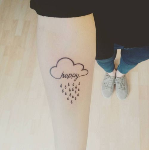 Happy cloud tattoo on the right inner forearm....