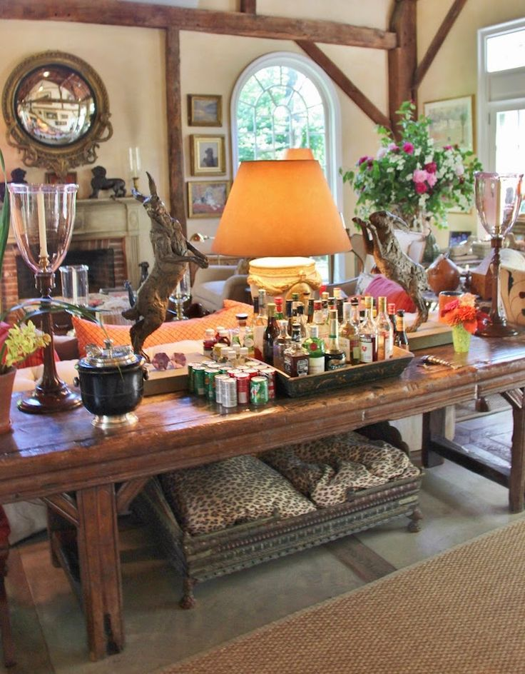 Home of Bunny Williams and John Rosselli .   Bunny says that if you want people to go in a room, have a drinks bar.   Via Laurel Bern Interiors