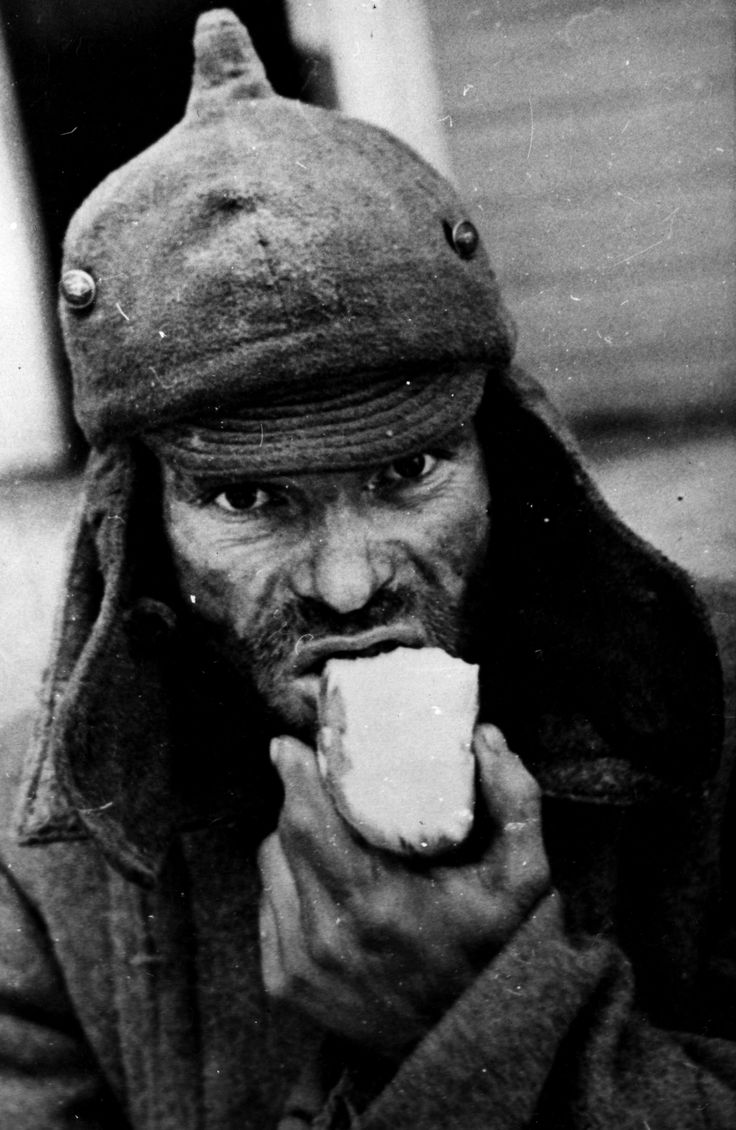 This face wins my Ugliest Face Award hands down. In all the years of researching WW2 visual material I don't think I have seen anything worse than this. Russian POW in Finnish internment camp, 1939. Also, note revolutionary Bolshevik helmet cap worn by the subject.