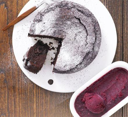Choc-cherry fudge torte with cherry sorbet. This divine, squidgy chocolate cake is dairy and wheat-free, so vegans can dig in!