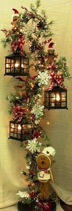 Christmas Decor: No Instructions....looks like a hook for plants....add lanterns.....flowers and a cute gingerbread!                                                                                                                                                                                 Mais