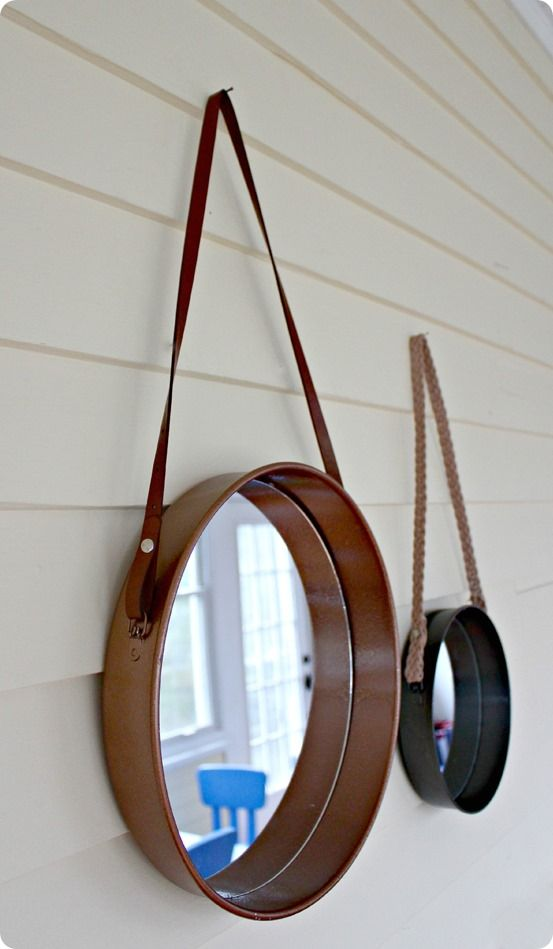 diy sailors mirror using an upcycled cake pan, leather hangers from thrift store belts, and a mirror.