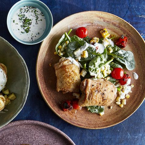Chicken With Blistered Corn and Tomato Salad | Trust us: You'll be making the corn and tomato salad as a side dish for picnics and parties for years to come. But the chicken can't be missed either. Searing skin-on chicken thighs in a very hot pan (the hotter the better when searing!) gives it that gorgeous golden-brown crust.