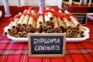 Tie a string candy (or a piece of ribbon..but dont eat it) around a pirouette cookie for edible diplomas!