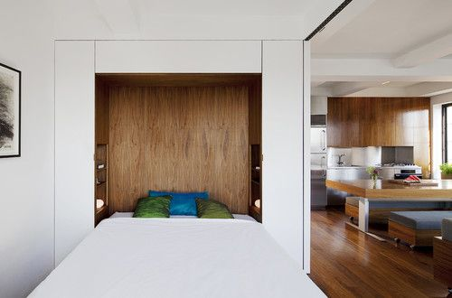 Murphy beds- the perfect small home guest room solution!!  I'd forgotten them!    modern bedroom by Studio Garneau