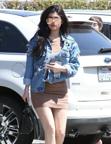 Reality star Kylie Jenner is spotted grabbing lunch with a friend at Kabuki, a Japanese Restaurant in Woodland Hills, California on June 23, 2016. She was wearing a distressed denim jacket with a brown skirt.