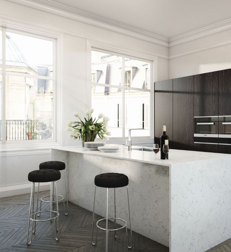 A glamorous kitchen featuring an essastone benchtop