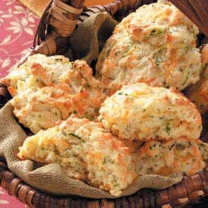 Zucchini Cheddar Biscuits Recipe -My husband grows a big garden, and our squash crop always seems to multiply! We give squash to everyone but still have plenty left over for making jelly, relish, pickles, breads, cakes and brownies. — Jean Moore, Pliny, West Virginia