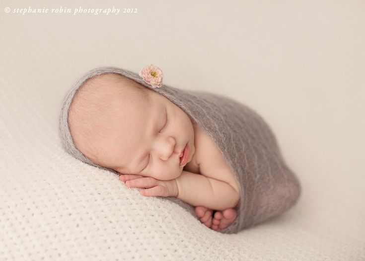 Newborn posing taco pose in the wrap and a ton of other advice