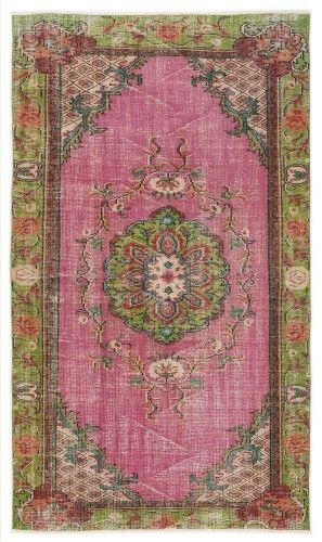 just spotted this beautiful pink vintage rug!