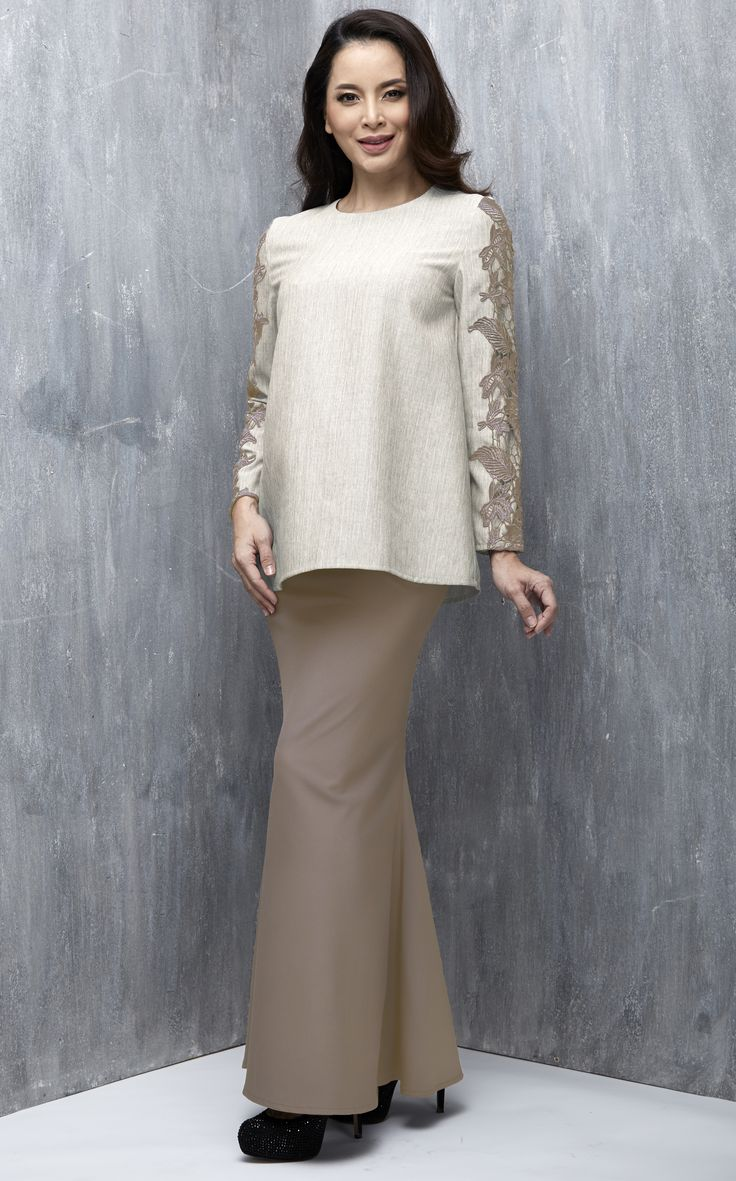 EMEL X DAPHNE IKING - LONGHORN - Modern A-line Baju Kurung with Lace (Nude) This A-line modern baju kurung is all about the class and simplicity with border lace on the sleeves. Also, the top is a tweed inspired fabric that's makes a lovely ensemble with the border lace. #emelxCLPTS #emelxDaphneIking #emelbymelindalooi #bajuraya #bajukurung #emel2016 #raya2016 #DaphneIking #nude #lace