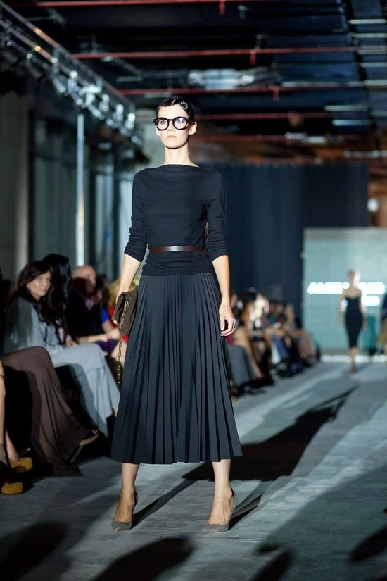 Black small pleated long skirt, black boat neck long sleeved top with thin brown belt and classic grey suede pumps and brown clutch suede bag
