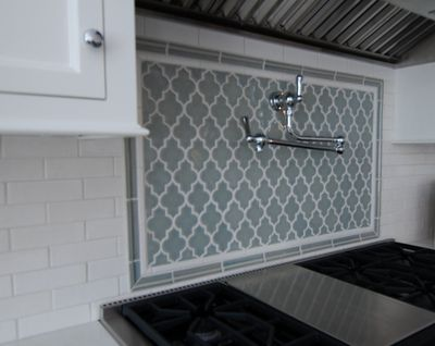 Moroccan flair - gray and white backsplah. Love the moroccan style  tile!!