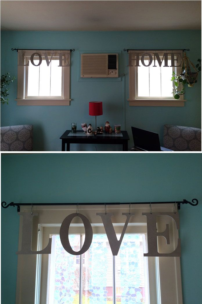 I had a hard time finding window treatments to fit my small living room windows, so I made my own. I bought wood letters from Jo-Ann Fabrics, drilled holes in the tops, and spray painted them metallic silver. Then I hung them using metal shower curtain hooks.