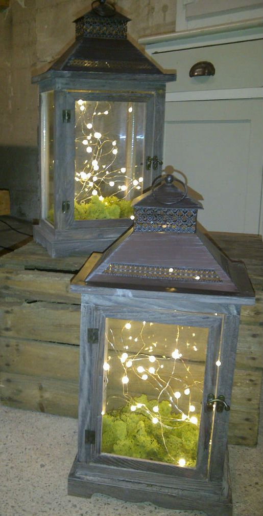 Rustic lanterns with fairy lights and moss