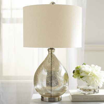 Our mercury glass lamp with a champagne-colored shade is worthy of a toast or two. Not only does it make an artful addition to your living space, but the price alone is cause for celebration.