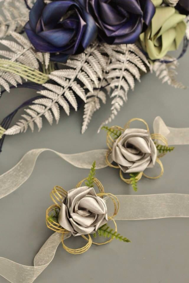 Wrist corsages with fern.         www.flaxation.co.nz