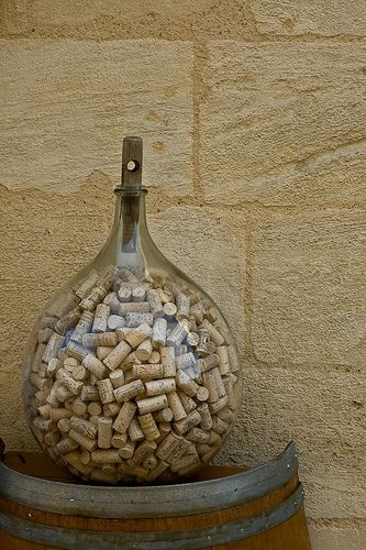 I keep ALL of my wine corks and display them in a glass jar.  Ok, so I don't have this many yet, but maybe I will someday!
