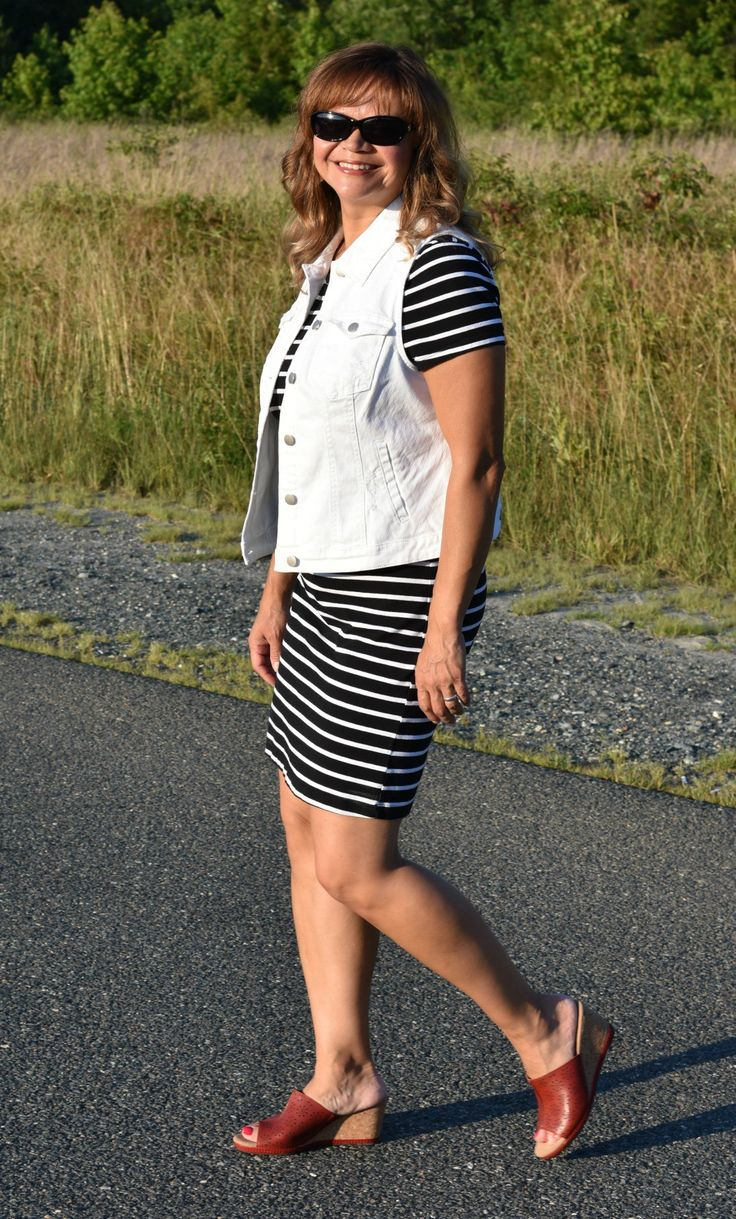 A white denim vest adds more personality to classic stripes.