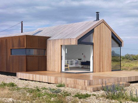 House on Dungeness beach clad in rusty steel mesh, silvery larch and grey cement fibreboard.