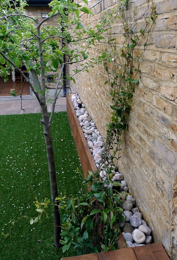Fake grass brick garden wall front garden company London Chelsea Wandsworth Clapham