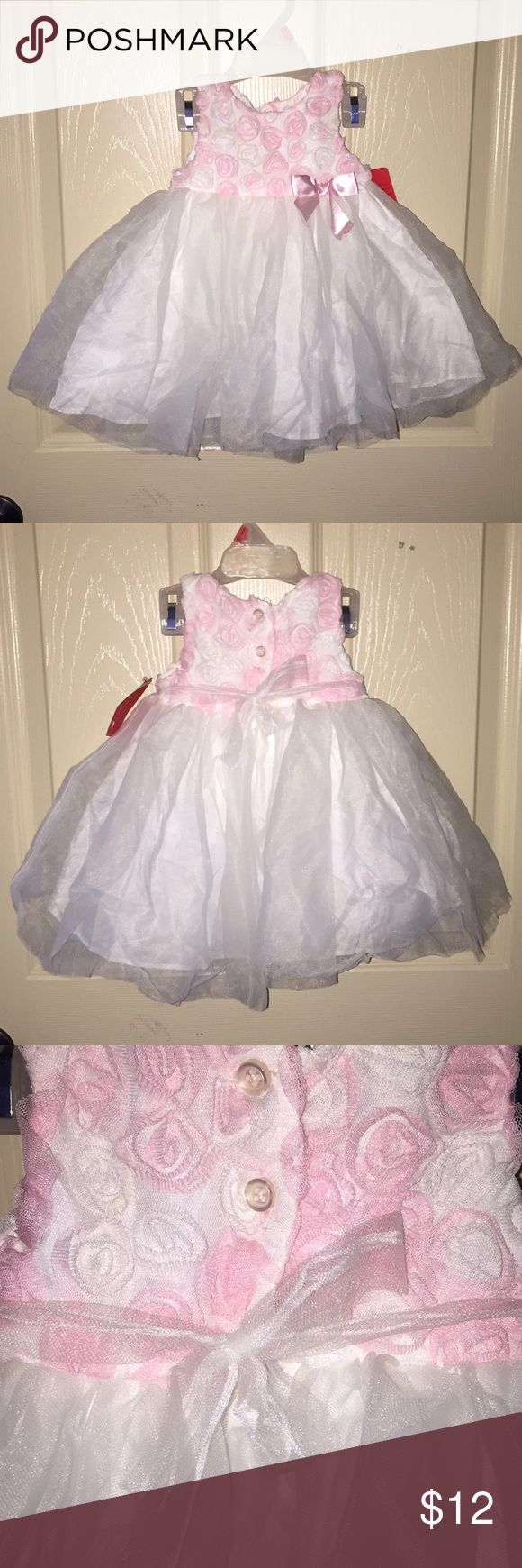 Marmellata 2 pc Dress Super cute for Easter or a wedding or any other occasion.  Cute white and pink roses with a pink bow.  Skirt has tulle.  Matching bloomers.  Bought at consignment store.  Never worn.  Price firm. Marmellata Dresses Formal