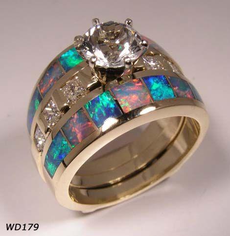 Opal & diamond wedding ring...with just one opal band, Beeeeautiful